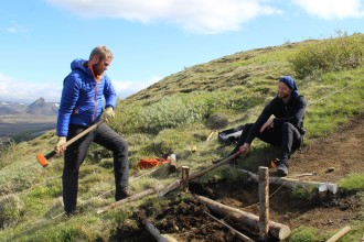Our summer staff building log steps on Valahnúkur